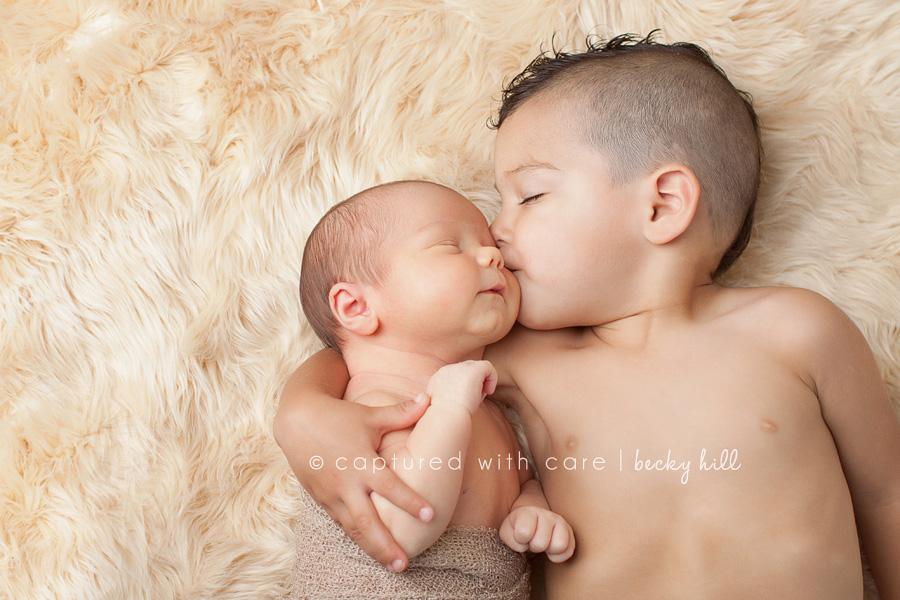 siblings, hug and kiss for baby